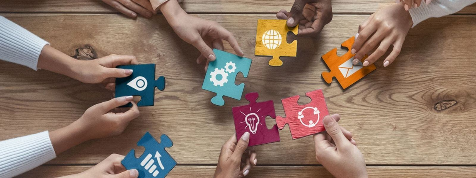 migrating pieces of a puzzle with pictures of communication elements on them such as gears or cogs for settings, location icon, a globe, and network icon.