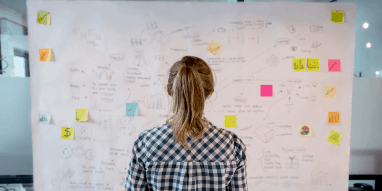 woman in front of white board