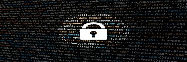 white lock icon over computer screen with code