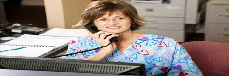 receptionist answering phone at desk