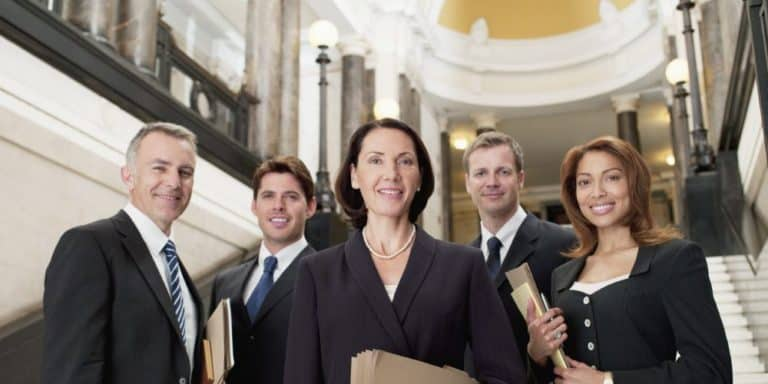 group of lawyers standing on stairs