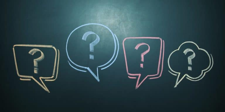 chalk board with chat bubbles and question marks