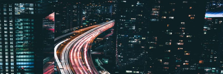 time lapse of city at night with cars